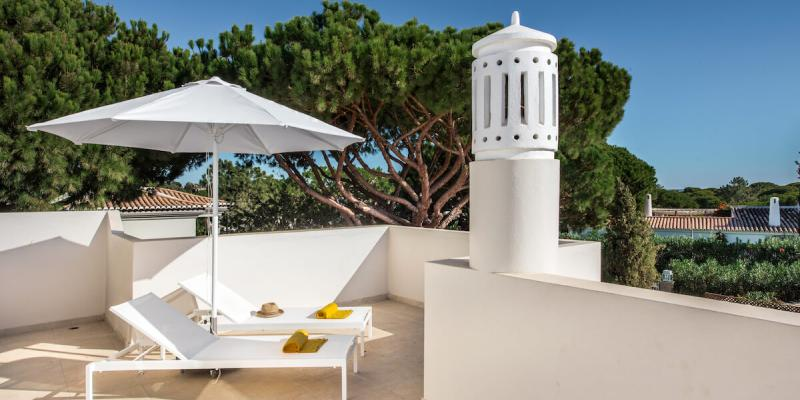 The private terrace outside Vlla Florabella in Portugal with distant sea views